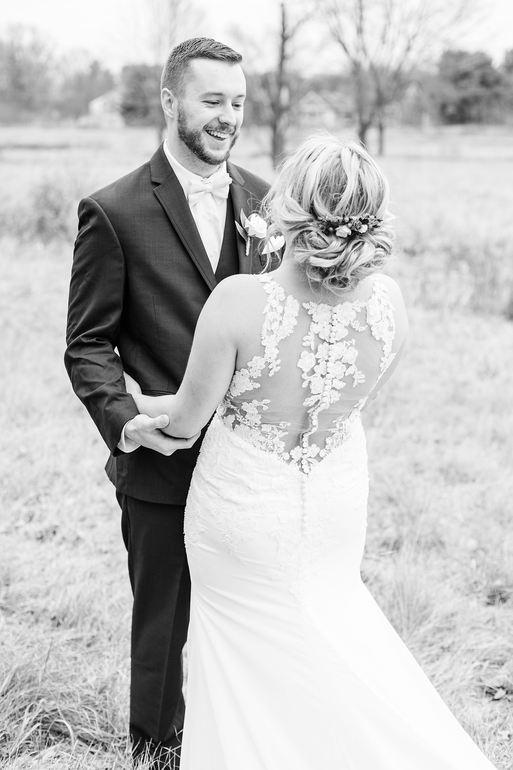josh and Andrea photography husband and wife team michigan winter wedding bride and groom first look