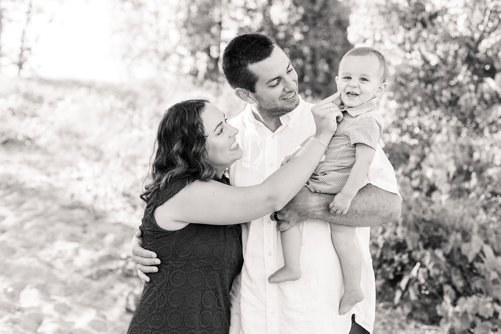 family of 3 photo session Silver Beach Saint Joseph Michigan laughing together