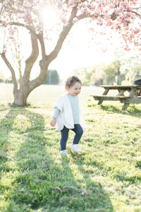 cute child girl playing in the grass