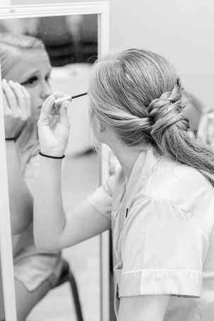 bridesmaid applying make up in mirror Milledgeville Georgia