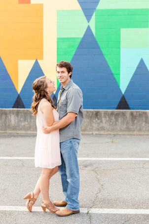 engagement photos cute couple painted wall downtown Milledgeville Georgia