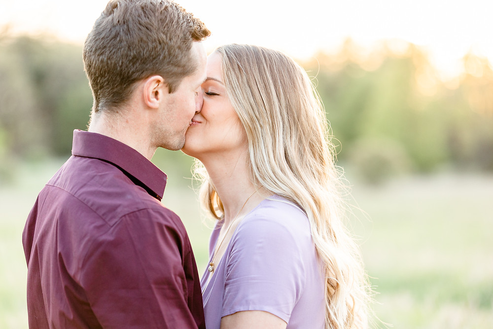 Josh and Andrea wedding photography husband and wife photographer team michigan Al Sabo Land Preserve engagement pictures session photo shoot fiance woods field smiling