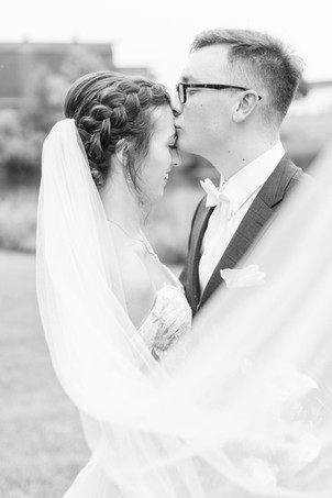 Bride and Groom kissing forehead Bridal bouquet fall colors Saint Patricks Park South Bend Indiana