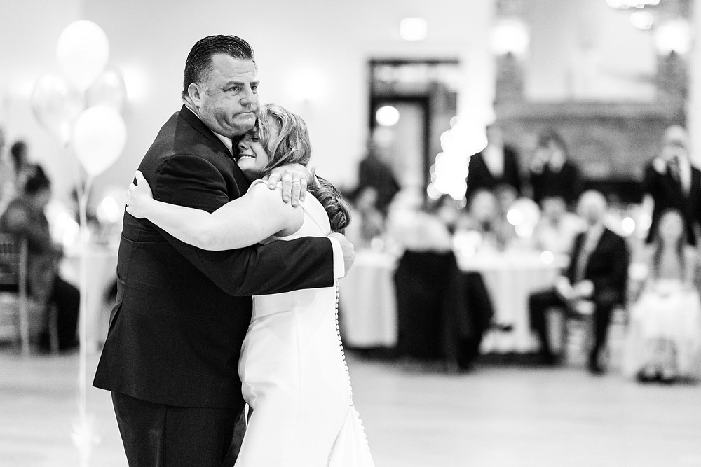 Josh and Andrea wedding photography husband and wife photographer team michigan venue Bay Pointe Woods shelbyville snow winter wedding reception father daddy daughter dance