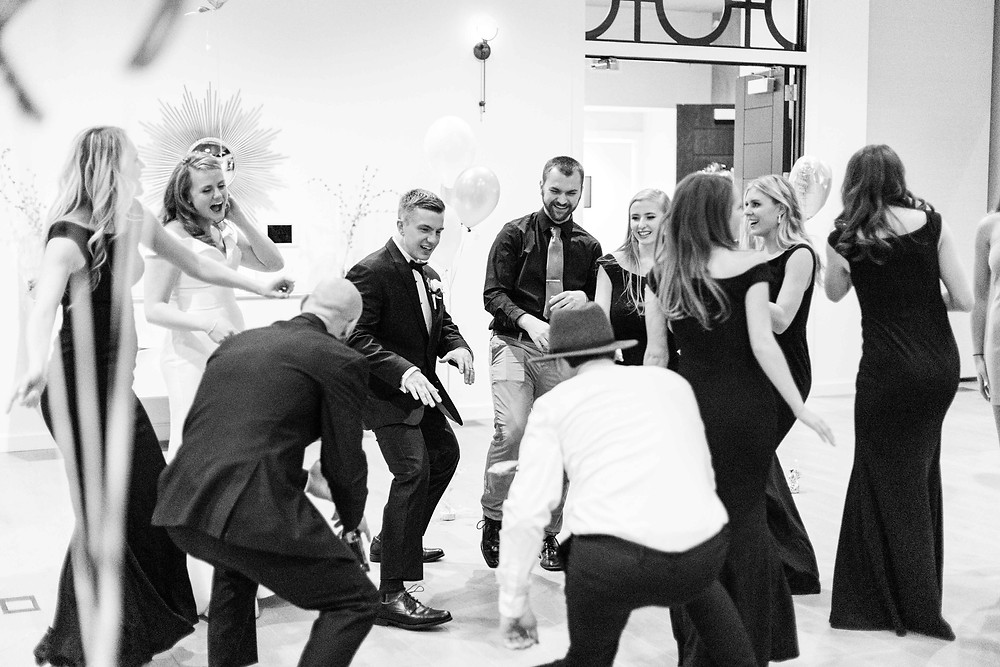 Josh and Andrea wedding photography husband and wife photographer team michigan venue Bay Pointe Woods shelbyville snow winter wedding reception bride and groom dancing