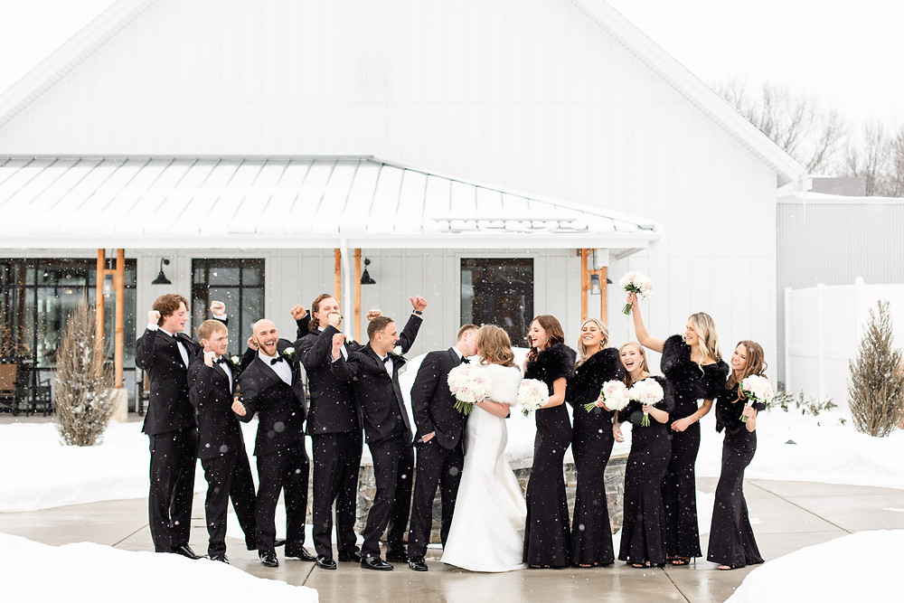 Josh and Andrea wedding photography husband and wife photographer team michigan venue Bay Pointe Woods shelbyville winter wedding bride and groom groomsmen bridesmaids bridal party black suit black dress