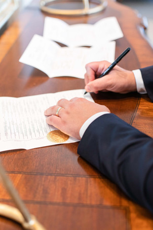 groom signing marriage contract ceremony Kent Country Club Wedding Grand Rapids
