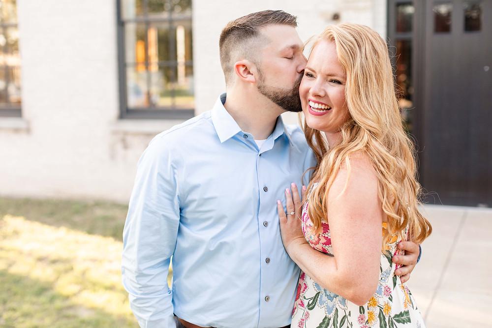 engagement photos couple kissing laughing journeyman distillery weddings three oaks michigan