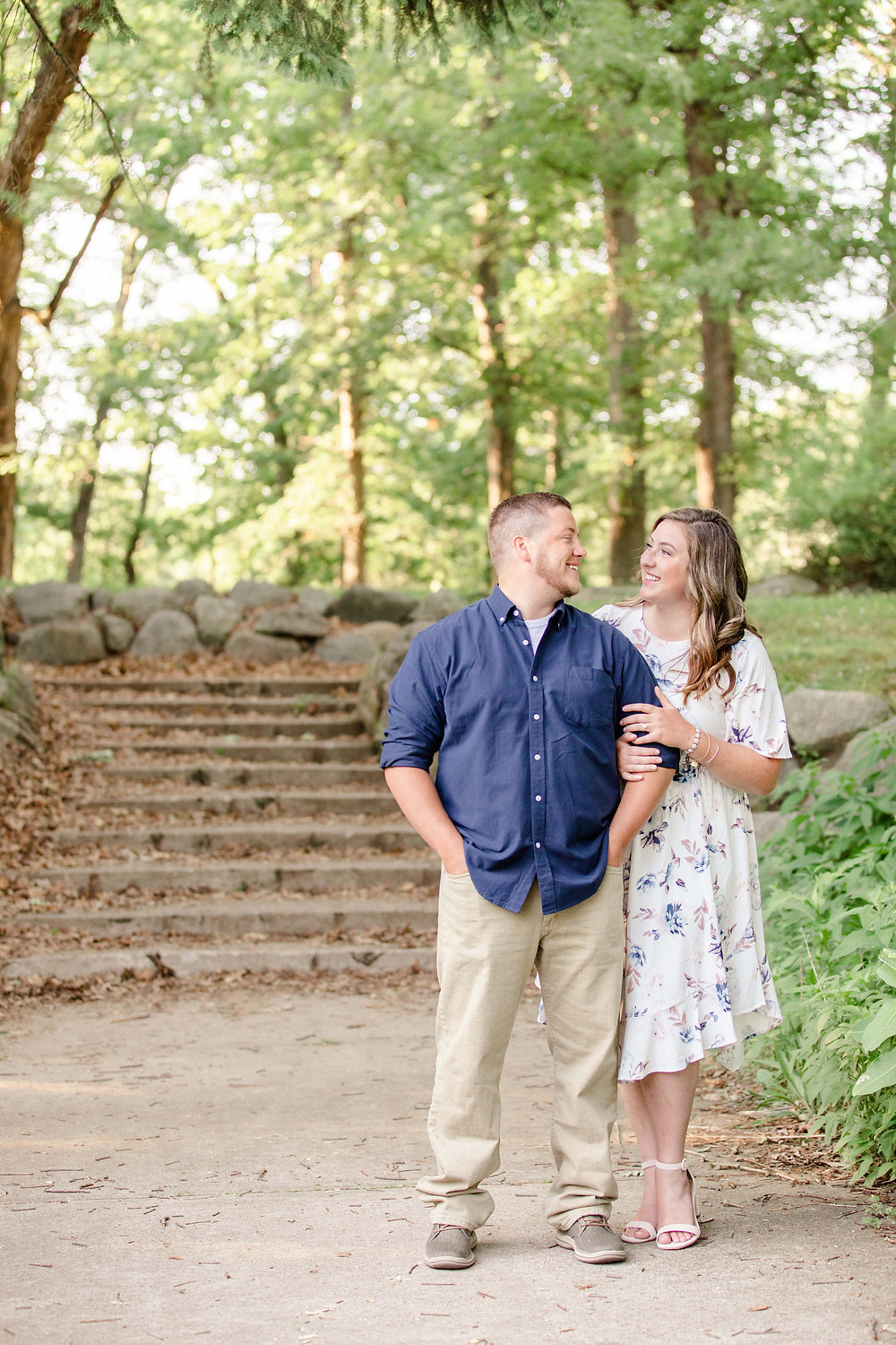 engagement photos cute couple arm in arm near stone steps at milham park kalamazoo michigan