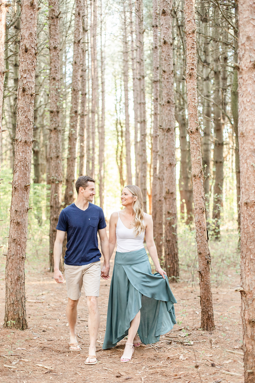 Josh and Andrea wedding photography husband and wife photographer team michigan Al Sabo Land Preserve engagement pictures session photo shoot fiance woods field walking