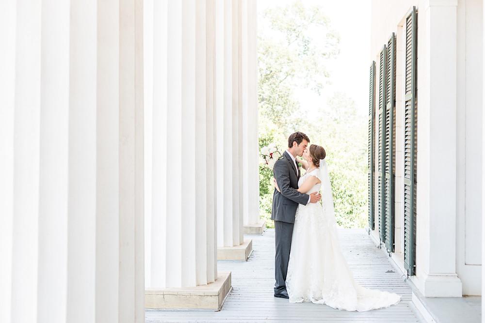 Bride and Groom Wedding kissing Rose Hill antebellum Lockerly Arboretum Milledgeville Georgia