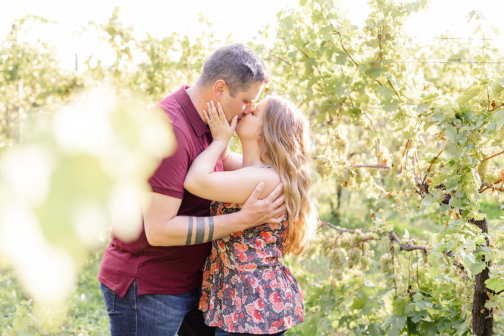 Engagement photos Round Barn Winery Baroda Michigan vineyard cute couple kissing
