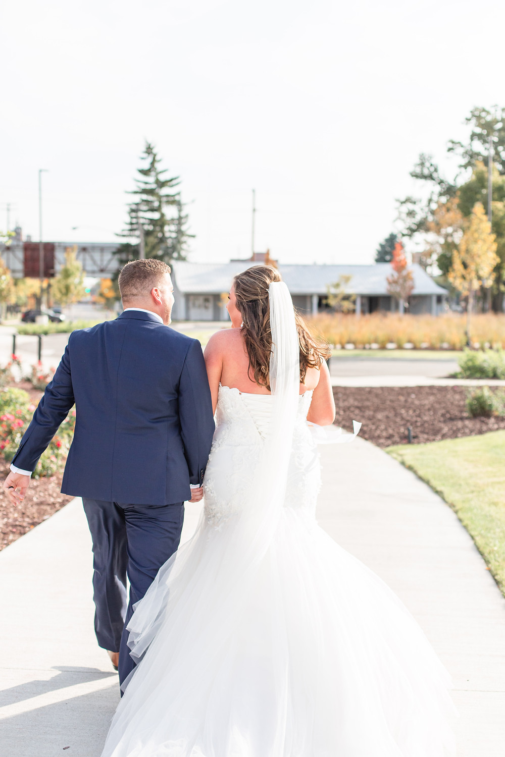 bride and groom walking away from ceremony American 1 event center Jackson michigan