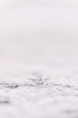 engagement ring on concrete stone at The Tridge Midland Michigan