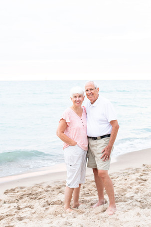 older couple standing on the beach Lake Michigan South Haven Michigan 50 years of marriage