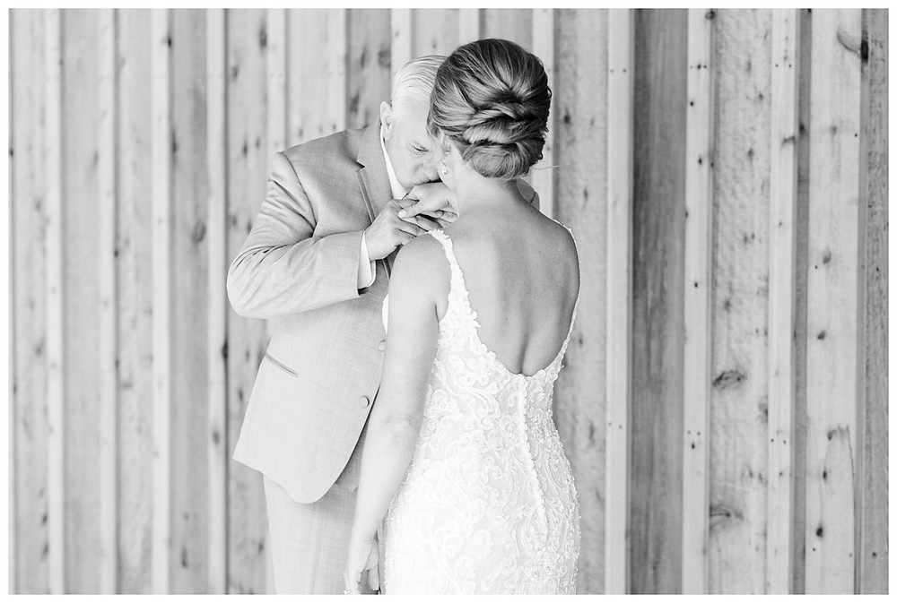 Josh and Andrea light airy joyful style wedding photography husband and wife photographer team michigan pictures photo shoot poses spring bride and groom White Oak Farm Venue first look father of the bride