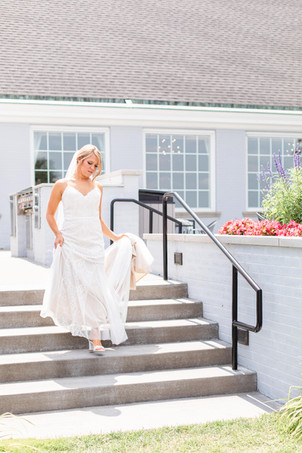 bride walking down steps for first look Kent Country Club Wedding Grand Rapids