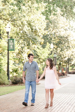 engagement photos cute couple walking holding hands Milledgeville GA Georgia College and State University