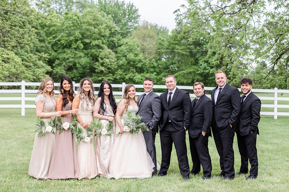 Josh and Andrea wedding photography husband and wife photographer team michigan pictures winter wedding hydrangea blu barn bride and groom apple orchard bridal party