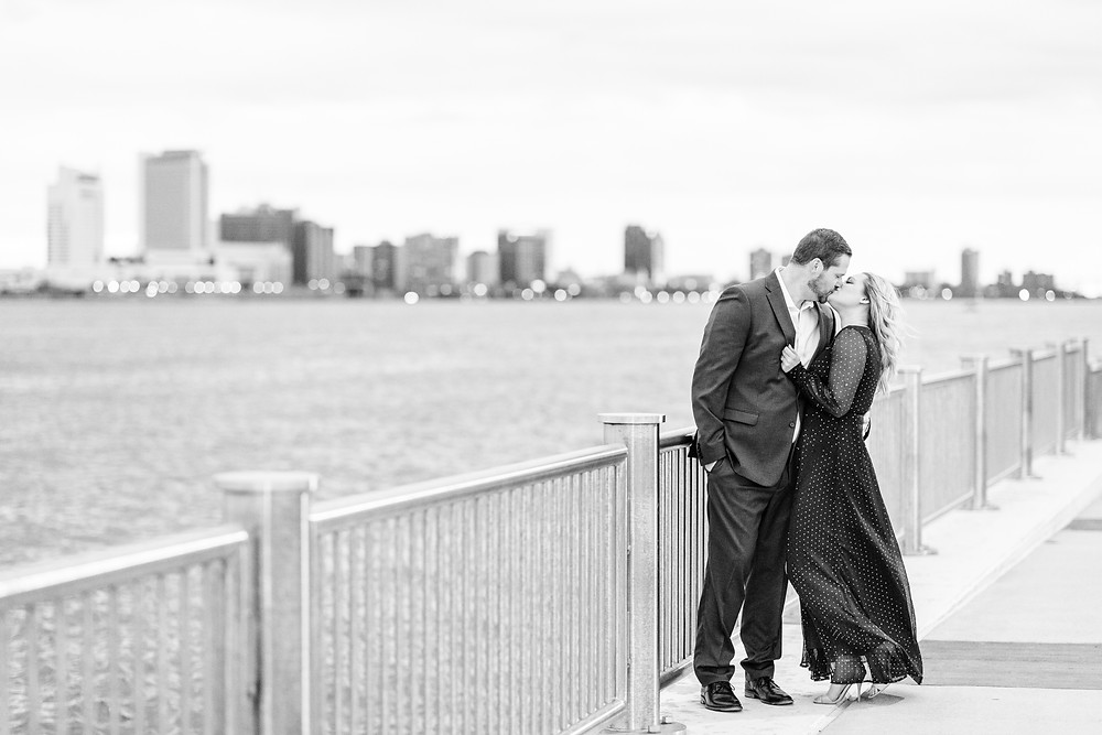 Josh and Andrea wedding photography husband and wife photographer team michigan engagement session photo shoot fiance detroit kissing
