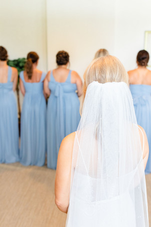 first look with bridesmaids Kent Country Club Wedding Grand Rapids