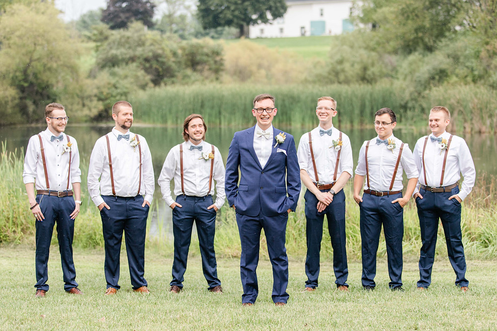 Groom and Groomsman laughing Saint Patricks Park South Bend Indiana