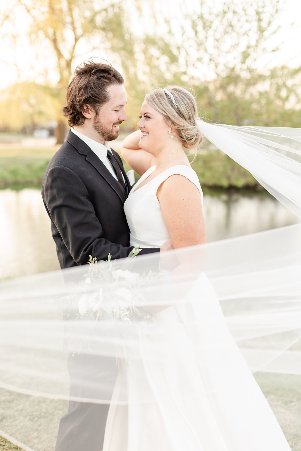 Josh and Andrea wedding photography husband and wife photographer team michigan Black Barn Wedding Venue rives junction spring bride and groom veil