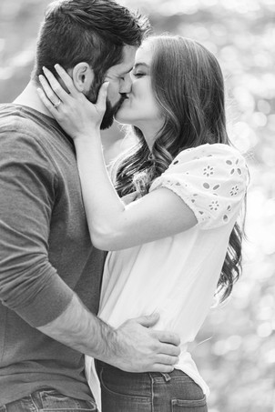 Cute couple kissing provin trails Grand Rapids engagement session