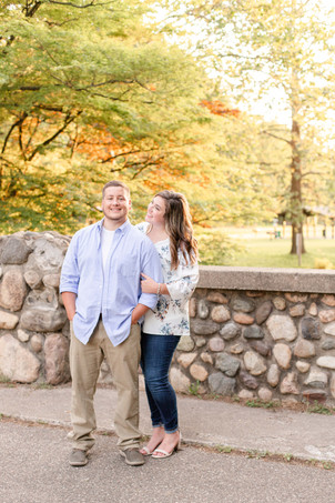 engagement photos cute couple walking on bridge milham park kalamazoo michigan