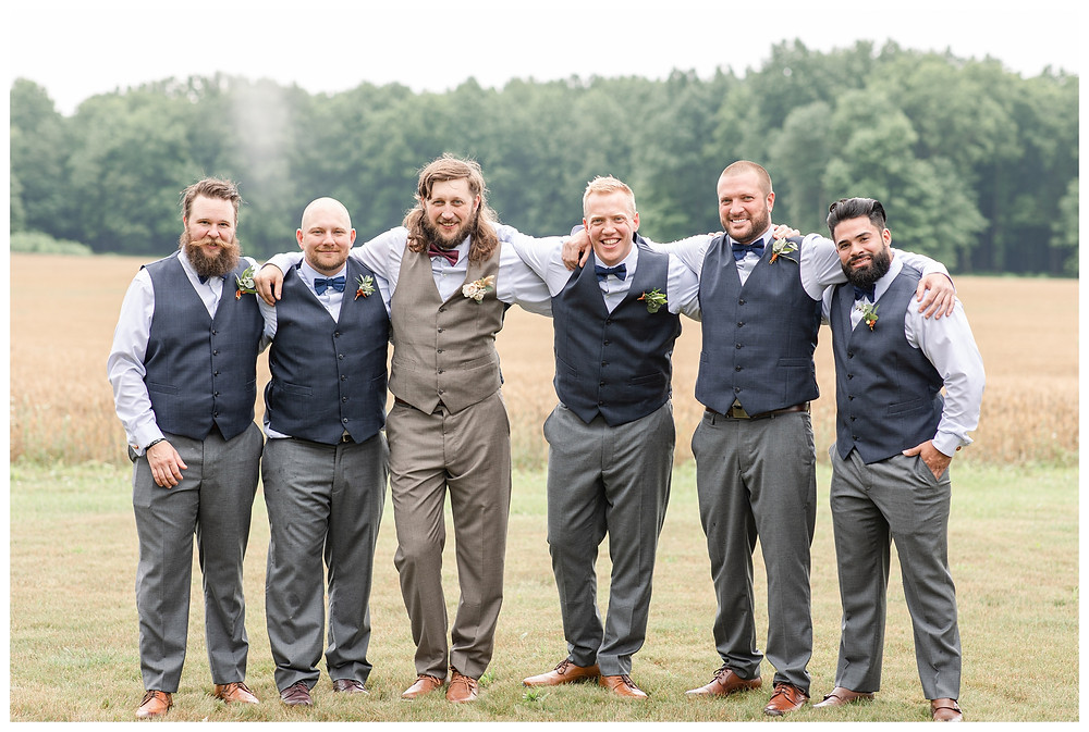 Josh and Andrea wedding photography husband and wife photographer team michigan pictures photo shoot farm barn spring bride and groom farm barn bridal party groomsmen
