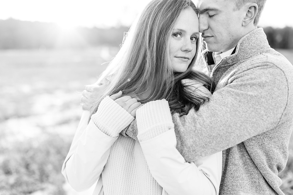 Josh and Andrea wedding photography husband and wife team michigan engagement session Al sabo land preserve couple standing in snowy field