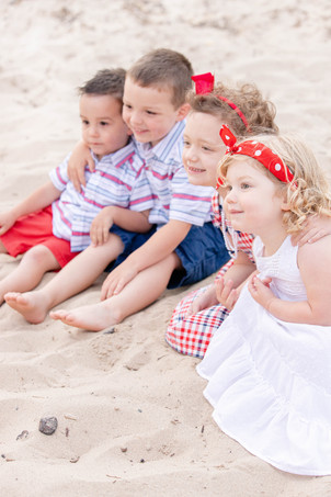 South Haven Family shoot small children cousins on the beach at Lake Michigan red white and blue outfits