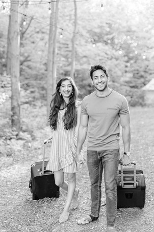 cute couple walking with suitcases down road The Fields of Michigan South Haven luxury glamping experience