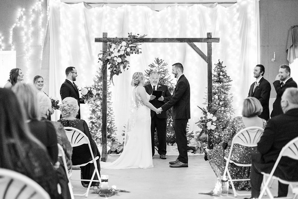 josh and Andrea photography husband and wife team michigan winter wedding ceremony