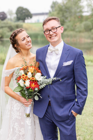 Bride and Groom smiling Bridal bouquet fall colors Saint Patricks Park South Bend Indiana