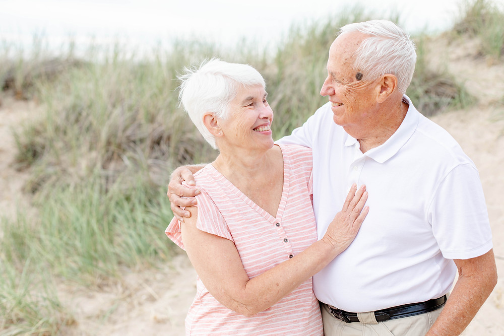 older couple laughing with each other 50 years of marriage Lake Michigan South Haven Michigan