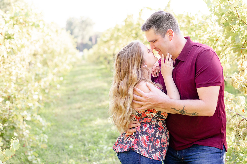Engagement photos Round Barn Winery Baroda Michigan vineyard cute couple laughing