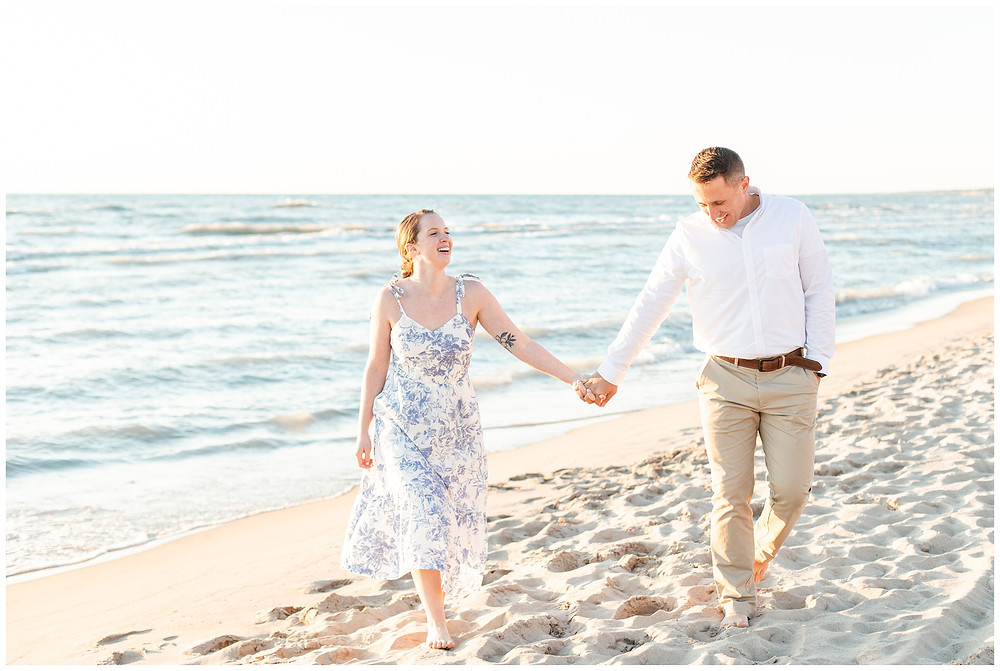 Josh and Andrea wedding photography husband and wife photographer team michigan pictures south haven engagement pictures session beach photo shoot fiance walking laughing