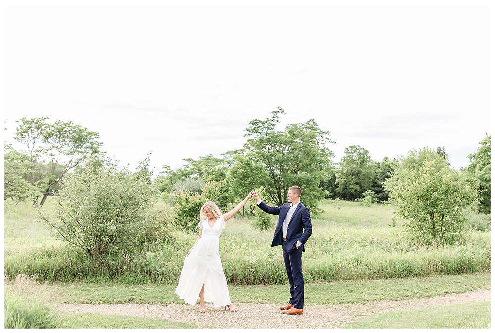 Josh and Andrea wedding photography husband and wife photographer team michigan pictures photo shoot hager park engagement pictures session photo shoot fiance grand rapids spinning twirling dancing