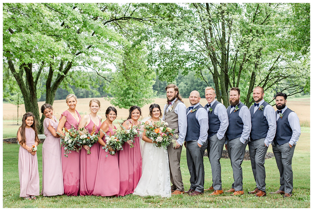Josh and Andrea wedding photography husband and wife photographer team michigan pictures photo shoot farm barn spring bride and groom farm barn bridal party bridesmaids groomsmen