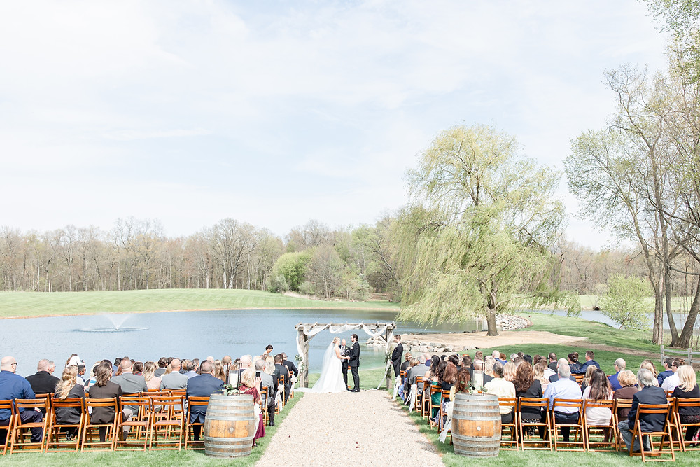 Josh and Andrea wedding photography husband and wife photographer team michigan Black Barn Wedding Venue rives junction spring bride and groom ceremony
