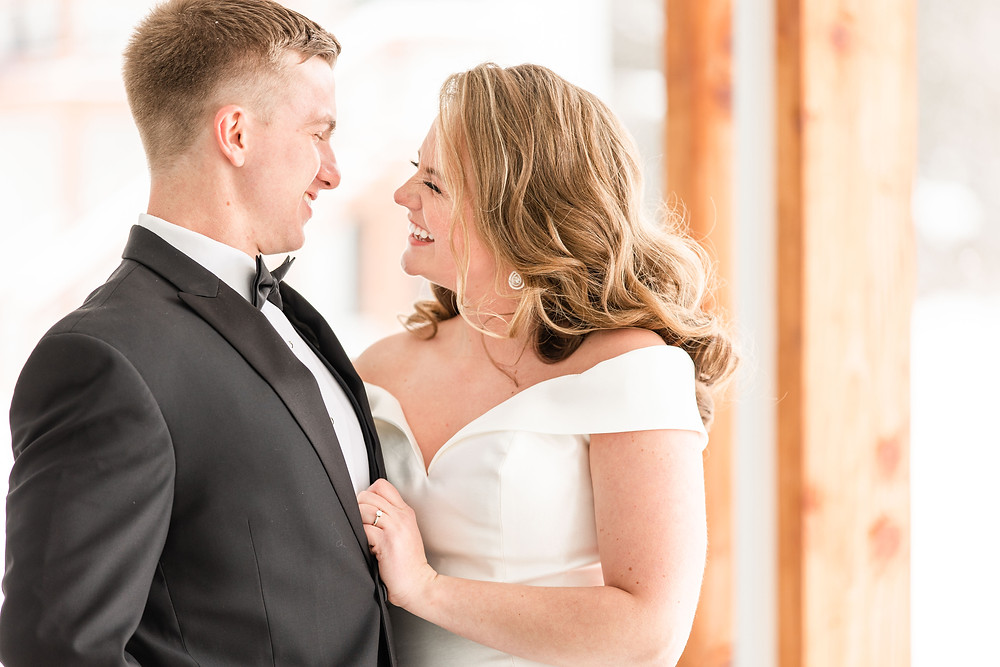 Josh and Andrea wedding photography husband and wife photographer team michigan venue Bay Pointe Woods shelbyville winter wedding bride and groom laughing smiling