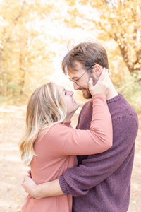 cute couple fall leaves south haven photo shoot