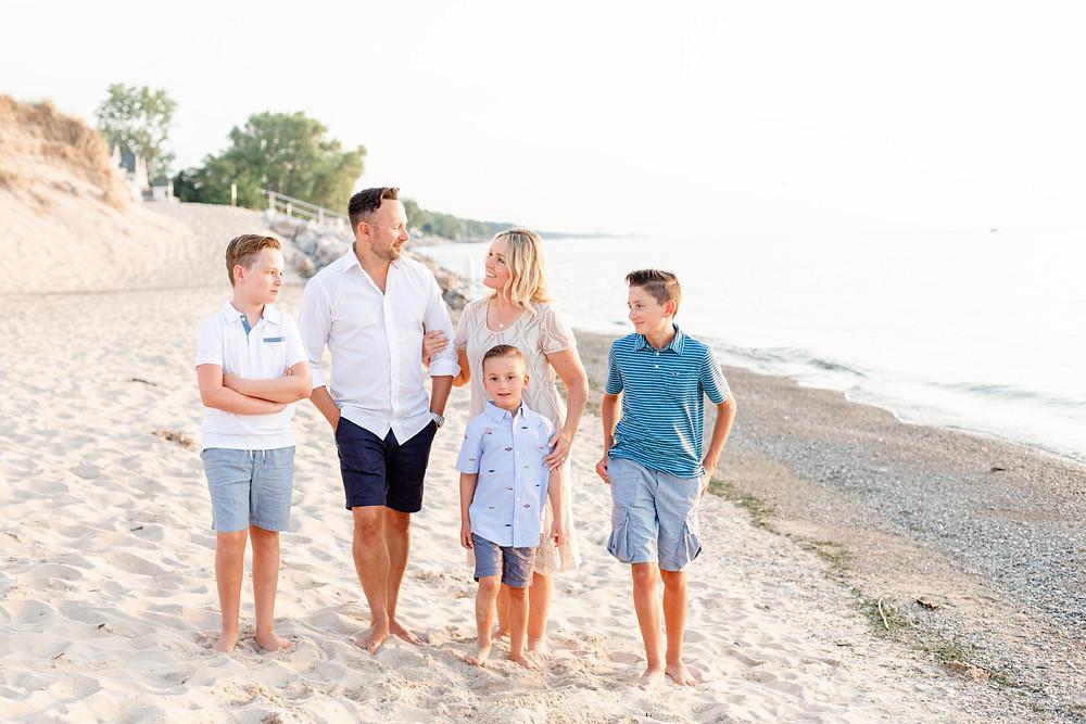 Family of 5 walking on beach Lake Michigan New Buffalo