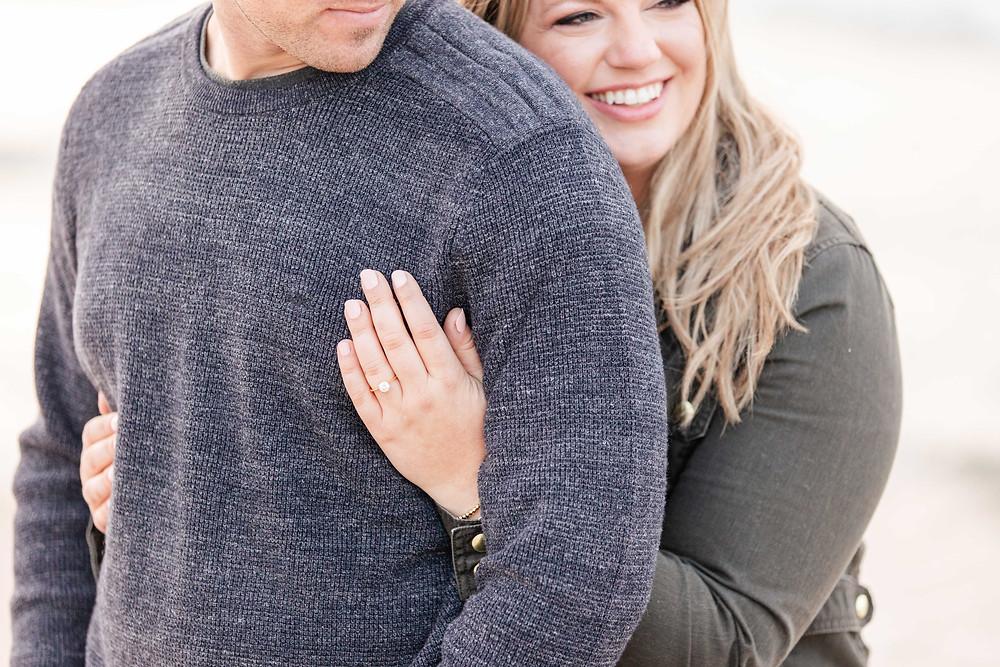 Engagement Photos Jean Klock Park Saint Joseph MI cute couple holding shoulder with engagement ring hand