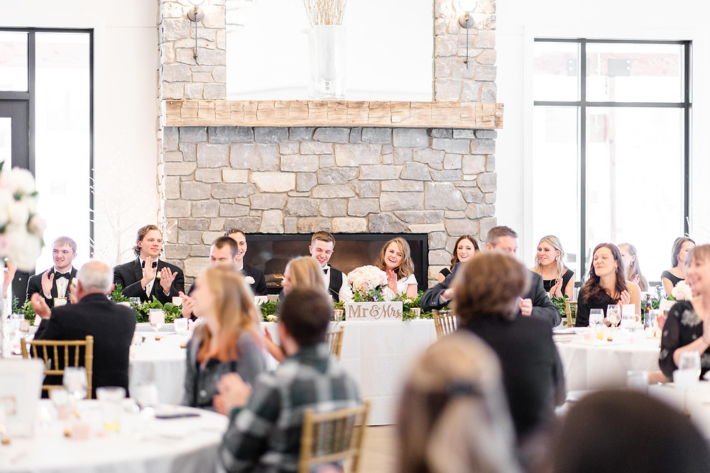 Josh and Andrea wedding photography husband and wife photographer team michigan venue Bay Pointe Woods shelbyville snow winter wedding reception bridal party table