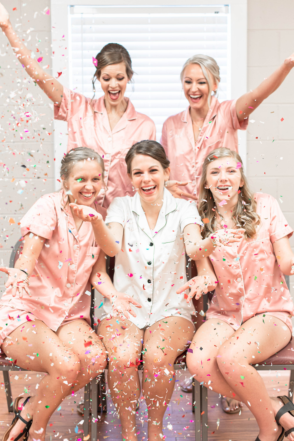 Bride and Bridesmaids tossing confetti celebration matching pjs Milledgeville Georgia