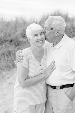 older couple kissing 50 years of marriage Lake Michigan South Haven Michigan
