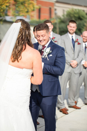 Bride and groom reading vows cute couple wedding American 1 event center Jackson michigan