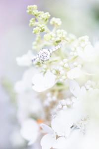 engagement ring on flowers journeyman distillery weddings three oaks michigan